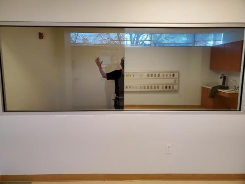 Clear glass (left) - 1 way privacy film (right)